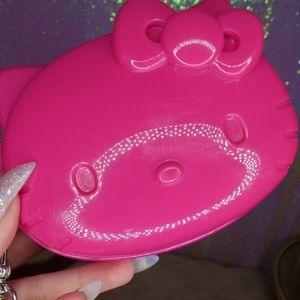 Pink vinyl Loungefly Hello Kitty head wristlet